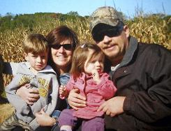 Diane and Daniel Schuler hold their children, Bryan, left, and Erin, in an undated photo.