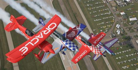 Pilots fly their aircraft in formation in July 2008 over the annual show in Oshkosh, Wis.