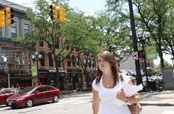 Stephanie Durphey, 21, a public relations intern at CreateMyTee.com, walks down Main Street in Ann Arbor, Mich., looking for restaurants to ask about advertising opportunities.