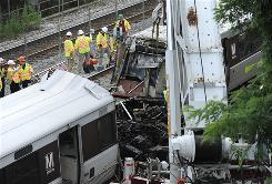 Workers sift through the remains of two Metrorail trains which collided on June 21, 2009.