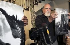 Rick Norsigian holds up a photograph made from a glass negative shot by the late photographer Ansel Adams during a news conference in Beverly Hills, on Tuesday.