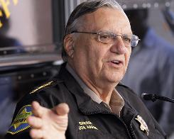 Maricopa County Sheriff Joe Arpaio answers questions during an April news conference to announce his latest crime suppression enforcement patrols in Phoenix. 