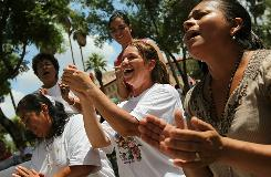Opponents of Arizona's immigration law celebrate after it was announced that a judge blocked some controversial provisions of the law on Wednesday in Phoenix.