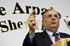  Maricopa County (Ariz.) Sheriff Joe Arpaio speaks to reporters Wednesday in Phoenix. U.S. District Judge Susan Bolton denied his legal request to have seven lawsuits against the law dismissed.