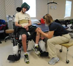 Physical therapist Barbara Darkangelo works with Army Staff Sgt. Cory Remsburg at James A. Haley Veterans Hospital in Tampa. Remsburg sufffered a brain injury in an IED blast in Afghanistan in fall.