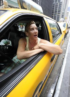 Jana Stroe, a New York City cab driver, has used a Ford Crown Victoria for 20 years.