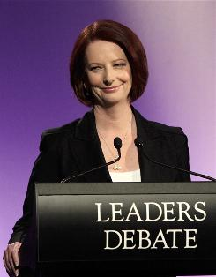 Australian Prime Minister Julia Gillard, shown here at a debate on Sunday, assured Christians that her atheism would not interefere with church-run welfare and education programs.