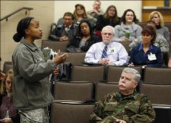 Psychiatrist Tangeneare Singh, left, speaks to counselors at a seminar on suicide prevention at Fort Campbell, Ky., on Jan. 21.
