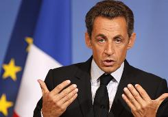 French President Nicolas Sarkozy speaks in Grenoble, French Alps, on Friday. Some opposition lawmakers have recently accused Sarkozy of pandering to the right with new proposals targeting Gypsies and immigrants suspected of crimes.