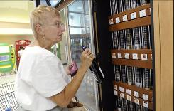Jacqueline Love purchases a bottle of wine from a self-serve kiosk at a Giant food store in Harrisburg, Pa.