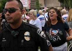 Tea Party activist Allison Culver shouts at opponents during a demonstration against illegal immigration this weekend in Phoenix.