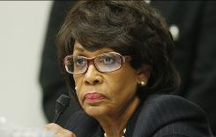 Rep. Maxine Waters, D-Calif., is seen on Capitol Hill in Washington. A House investigative panel has charged Waters with violating ethics rules.  