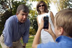 Missouri Rep. Roy Blunt is interviewed by son Charlie Blunt, 5, as Abby Blunt watches Saturday at a GOP event in Springfield. Blunt is one of the best-known last names in the state.