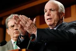 Sens. John McCain, R-Ariz., and Tom Coburn, R-Okla., speak about stimulus projects.