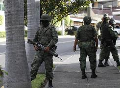 Soldiers guard a street in the area where Mexican drug cartel leader Ignacio Coronel Villareal, aka Nacho Coronel was allegedly killed during an army raid in Zapopan, near Guadalajara, Mexico on July 29.