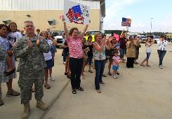 Family members welcome home soldiers of the Louisiana Army National Guard from their deployment in Afghanistan on May 12 in Hammond, La.