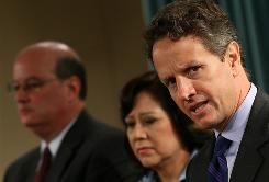 Treasury Secretary Timothy Geithner, Secretary of Labor Hilda Solis and Social Security Administration Commissioner Michael Astrue speak to reporters Thursday.