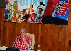Cuba's former leader Fidel Castro speaks with youth at the Havana Convention Center on July 30 in this photo from the state-run Cubadebate website.