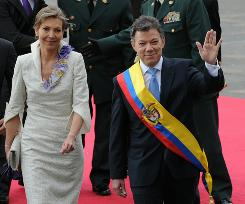 Colombian President Juan Manuel Santos and his wife, Maria Clemencia Rodriguez, participate in inauguration ceremonies on Saturday.