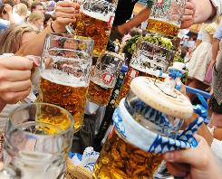 Beer drinkers raise their glasses for a toast at Ocktoberfest in Germany. Because of an obscure state law, a big amateur brewer competition has been canceled in the U.S.