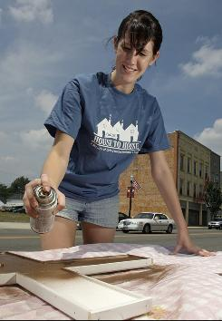 Miami University student Christine Montgomery helps remodel Restore Community Center in her spare time during her internship in Ada, Ohio.