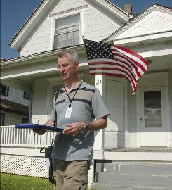 Census worker Timothy Culp-Northwood visits homes in June in Racine, Wis.