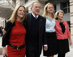 Former Alaska Sen. Ted Stevens stands with his daughters, from left, Beth Stevens, Lily Stevens and Susan Covich as he leaves federal court in Washington on April 7, 2009.