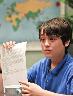Jonathan Lee shows a letter which he will give to North Korea leader Kim Jong Il.