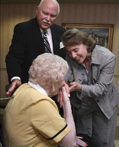Rick Fleetwood, top, watches as his mother, Jean Fleetwood, 82, kisses the hand of Sen. Blanche Lincoln, D-Ark., at Briarwood Nursing and Rehabilitation Center in Little Rock after Lincoln spoke to residents Tuesday about the upcoming 75th anniversary of the Social Security Act.
