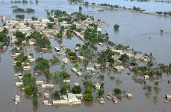 Flood waters cover the land as seen from a Pakistan Army helicopter on an aid mission Friday in Sukkur, Pakistan.