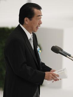 Japanese Prime Minister Naoto Kan speaks during a ceremony for war dead at Budokan martial arts hall in Tokyo on Sunday.