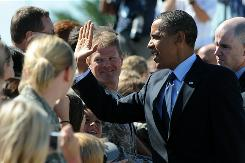 President Obama greets soldiers and their families Monday in Milwaukee.