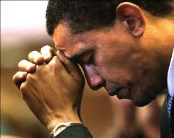 President Obama, then a Democratic senatorial candidate, prays at Trinity United Church of Christ in Chicago on Oct. 31, 2004.