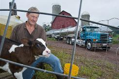 Bill Graby, at his Sullivian County, N.Y., dairy farm, says gas drilling lease contracts will help farms like his when milk prices are at a 20-year low.