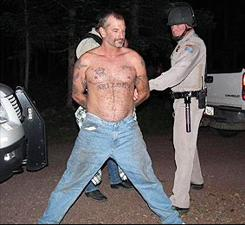 John McCluskey is taken into custody at a campground in Apache County, Arizona on Thursday night. McCluskey and his fiancee Casslyn Welch were on the runfor nearly three weeks after McCluskey escaped from an Arizona prison.