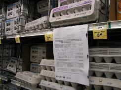 A San Francisco supermarket displays a note Sunday outlining which brands have been recalled.