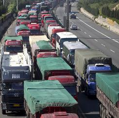 A section of the Beijing-Zhangjiakou highway in Huailai, in north China's Hebei province, crawls due to a massive traffic jam that stretches for dozens of miles and hit its 10-day mark on Tuesday.