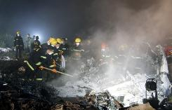 Rescuers work at the site of a reported plane crash at an airport in northeast China's Heilongjiang province on Tuesday.