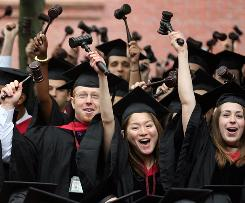 Graduating Harvard University Law School students stand and wave gavels in celebration, but more students are unhappy with the job market.
