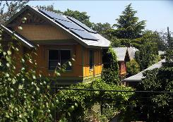 David Sweet's Northeast Portland home is one of many in the neighborhood to derive energy from solar panels purchased at a discounted cost.