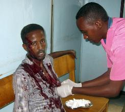 A nurse treats a wounded civilian Tuesday at Medina hospital in Mogadishu after he was wounded by mortar shrapnel during fighting between Somali insurgents and African Union troops.