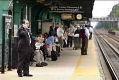 Commuters wait at the Princeton Junction, N.J., train station Tuesday after power problems forced Amtrak and regional transit agencies to halt trains throughout the Northeast.