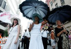 Musician Charmaine Neville helps lead a jazz funeral to honor Katrina victims on Wednesday in New Orleans.