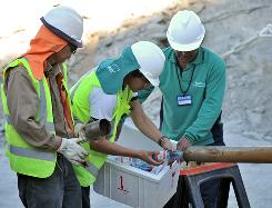 Crews send bottled water into the shaft. The trapped men haven't yet been told it may be months before they can be freed. A team of psychologist has been assembled to talk to each miner and officials are considering sending down antidepressants.
