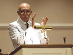Kenneth Haynes Sr. leads a Bible study at Main St. Missionary Baptist Church, where members of the community came for aid following Katrina.