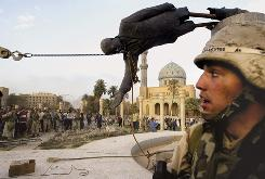 The statue of Saddam Hussein topples April 9, 2003. Saddam was convicted of crimes against humanity in 2005 and sentenced to hang.