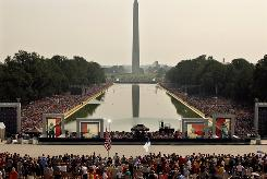 "Thousands of people fill the National Mall from the Lincoln Memorial to the World War II Memorial during the ""Restoring Honor"" event in Washington."