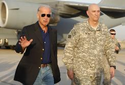 Vice President Biden walks with Gen. Ray Odierno at the Baghdad airport Monday. He said he expects a smooth handover to Iraqi control.