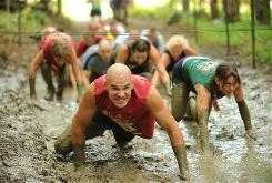 Cary Petrovich, 39, of Lorton, Va., hits the mud and low crawl section in the Run Amuck event on Aug. 14. He finished in 42:29.