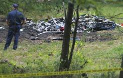 A helicopter ambulance crashed early Tuesday in central Arkansas, killing three crewmembers who were trying to reach a person injured in a traffic accident.